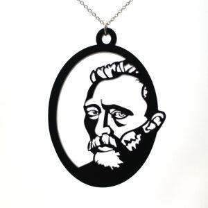 Deze halsketting is een moderne uitvoering van het bekende zelfportet van Van Gogh. Gemaakt van acrylaat.
