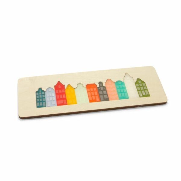 Amsterdamse puzzel met puzzelstukjes in vorm van grachtenhuizen